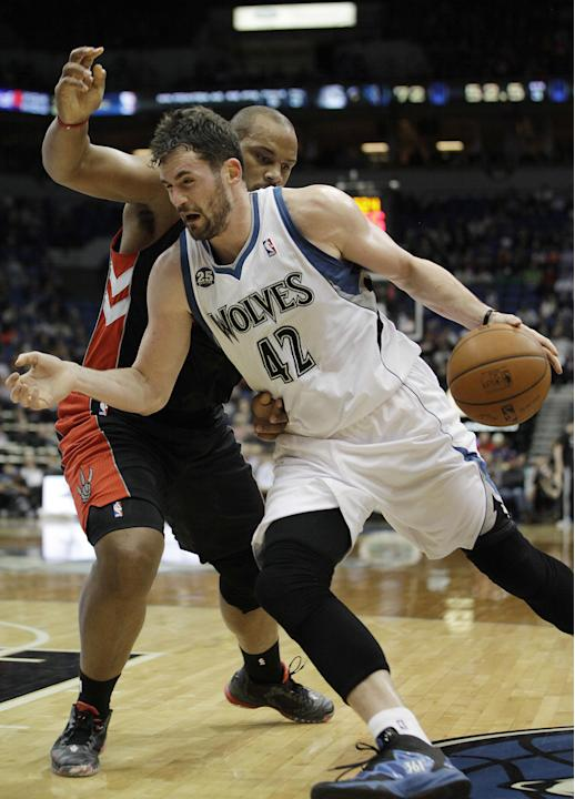 Minnesota Timberwolves forward Kevin Love (42) pushes the ball around Toronto Raptors forward Chuck Hayes (44) in the second half of an NBA basketball game, Sunday, March 9, 2014, in Minneapolis. The