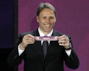 Former Dutch player van Basten draws Germany during the draw of the Euro 2012 soccer championship at the Palace of Arts in Kiev