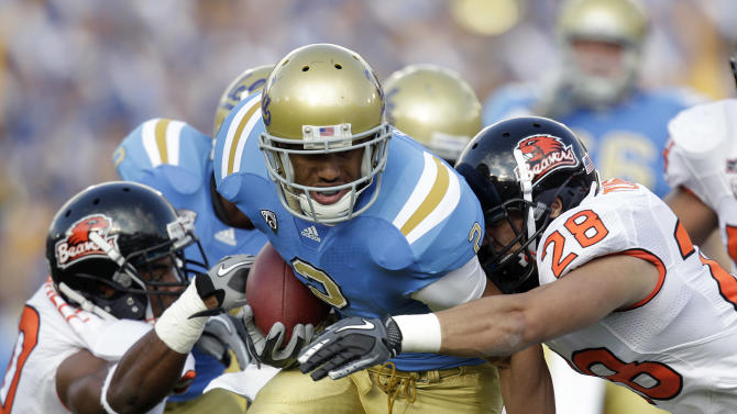 UCLA  running back Anthony Barr, center, is tackled by Oregon State safety Suaesi Tuimaunei, right, during the first half of an NCAA college football game at the Rose Bowl in Pasadena , Calif. Saturday, Nov. 6, 2010. (AP Photo/Jae C. Hong)