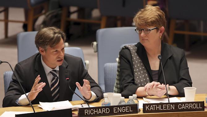 NBC News chief foreign correspondent Richard Engel, left, addresses a United Nations Security Council meeting on the protection of civilians in armed conflict and the protection of journalists, Wednesday, July 17, 2013 at U.N. headquarters. Karhleen Carroll, Associated Press executive editor and vice chair of the board of the Committee to Protect Journalists, listens at right. (AP Photo/Mary Altaffer)