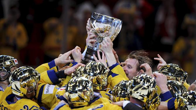 Swedish players react after winning the 2013 Ice Hockey IIHF World Championships gold medal match against  Switzerland, at the Ericsson Globe Arena in Stockholm, Sweden, Sunday, May 19, 2013. (AP Photo/Lehtikuva, Martti Kainulainen) FINLAND OUT. NO THIRD PARTY SALES.