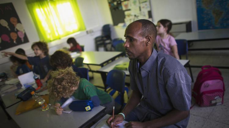 Angesom Solomon, an African migrant from Eritrea, attends Hebrew lesson at a school in Tel Aviv