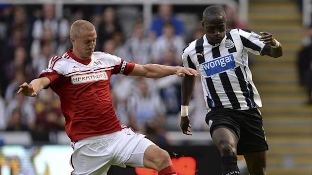 Fulham's Brede Hangeland challenges Moussa Sissoko of Newcastle (Reuters)