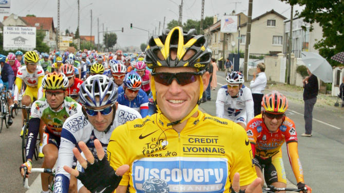 FILE - In this July 24, 2005, file photo, overall leader Lance Armstrong signals seven for his seventh straight win in the Tour de France cycling race as he pedals during the 21st and final stage of the race between Corbeil-Essonnes, south of Paris, and the French capital. U.S. Anti-Doping Agency chief executive Travis Tygart said Thursday, Aug. 23, 2012, that the agency will ban Armstrong from cycling for life and strip him of his seven Tour de France titles for doping. Armstrong on Thursday night dropped any further challenges to USADA's allegations that he took performance-enhancing drugs to win cycling's premier event from 1999-2005. (AP Photo/Peter Dejong, File)