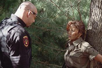 Romeo (Bill Goldberg) intimidates Maggie (Kiana Tom) in Universal Soldier: The Return