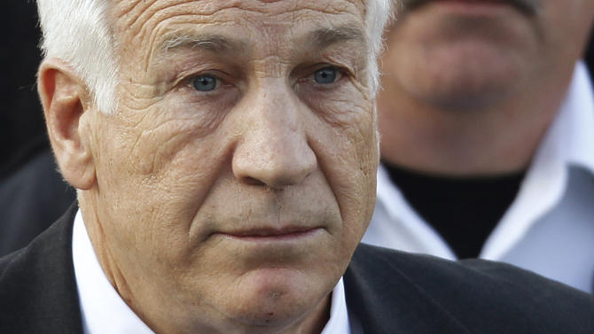 FILE - In this Dec. 13, 2011 file photo, Jerry Sandusky, the former Penn State assistant football coach charged with sexually abusing boys, leaves the Centre County Courthouse in Bellefonte, Pa. A young man who testified against Jerry Sandusky is suing Penn State, blaming the university for how its top officials dealt with complaints that the former assistant football coach was behaving inappropriately with boys. The lawsuit filed Friday, Aug. 24, 2012 by the man, called Victim 1 at Sandusky's trial, said Penn State officials made deliberate decisions not to report Sandusky to authorities.  (AP Photo/Matt Rourke, File)
