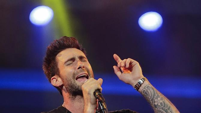 FILE - This Jan. 7, 2013 file photo shows Maroon 5 lead singer Adam Levine  during the Consumer Electronics Show in Las Vegas. Taylor Swift, Maroon 5 and fun. are finalists in 11 categories at the Billboard Music Awards, announced Monday, April 22. Swift, Maroon 5, Rihanna, One Direction and Justin Bieber will compete for the top artist award. The Billboard Music Awards will air live May 19 from the MGM Grand Garden Arena in Las Vegas on ABC. (AP Photo/Julie Jacobson, file)