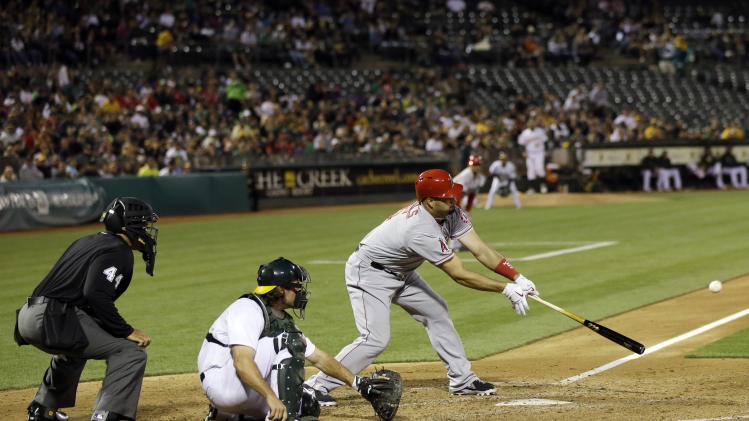 Los Angeles Angels' Albert Pujols drives in a run with a single against the Oakland Athletics during the fifth inning of a baseball game on Monday, April 29, 2013 in Oakland. Calif. (AP Photo/Marcio Jose Sanchez)