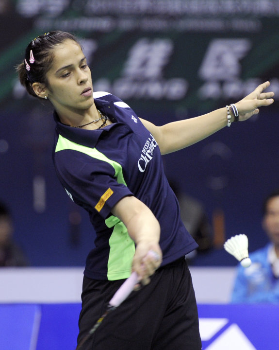 Saina Nehwal of India serves to Bae Youn