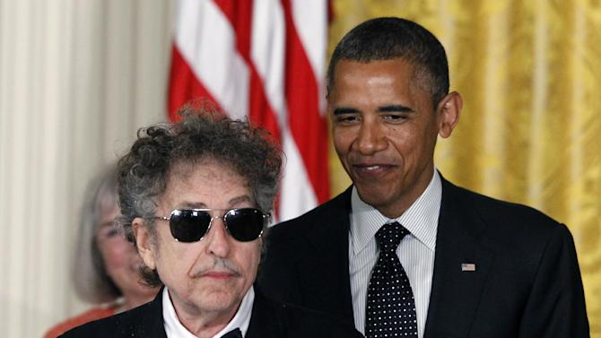 FILE - In this May 29, 2012, file photo, President Barack Obama stands Bob Dylan before awarding Dylan the Medal of Freedom during a ceremony in the East Room of the White House in Washington. Dylan said Monday, Nov. 5, 2012, during a concert, that he thinks President Barack Obama is going to win the election by a landslide.(AP Photo/Charles Dharapak, File)