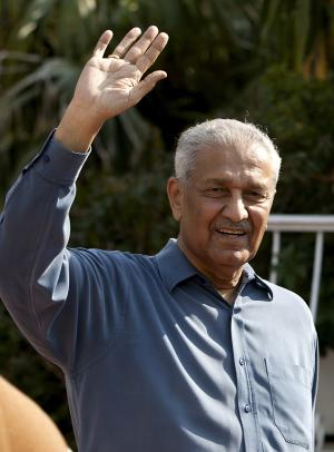 FILE - In this Feb, 6, 2009 file photo, Pakistan's nuclear scientist Abdul Qadeer Khan waves outside his residence in Islamabad, Pakistan. Khan, who made Pakistan into a nuclear power and later took responsibility for leaking atomic secrets to Iran, North Korea and Libya has started a new movement aimed at shaking up the country's political scene ahead of upcoming national elections. (AP Photo/B.K.Bangash, File)
