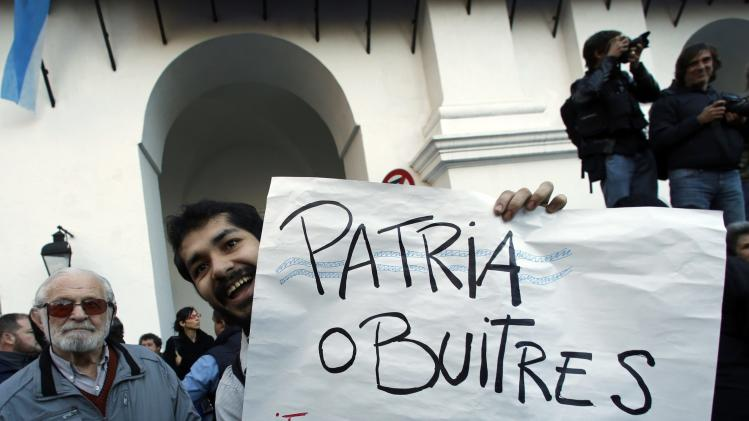 A man holds up a sign during a demonstration in support of Argentina's government outside Buenos Aires' Historical Cabildo