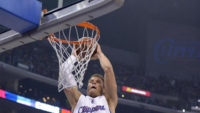 Los Angeles Clippers forward Blake Griffin, left, dunks as Los Angeles Lakers guard Steve Nash looks on during the first half of their NBA basketball game, Friday, Jan. 4, 2013, in Los Angeles.  (AP Photo/Mark J. Terrill)