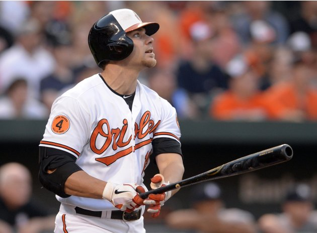 Baltimore Orioles batter Chris Davis watches his second inning home run off of New York Yankees starting pitcher CC Sabathia in Baltimore