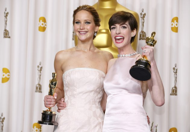 Jennifer Lawrence and Anne Hathaway pose with their Oscars backstage at the 85th Academy Awards in Hollywood