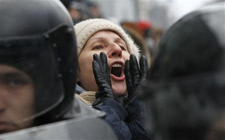 A woman shouts a slogan during a rally organized by supporters of EU integration in central Kiev