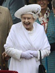 Britain&#39;s Queen Elizabeth II smiles during the river pageant commemorating her Diamond Jubilee, on the River Thames in London, Sunday June 3, 2012. (AP Photo / Dylan Martinez, pool)