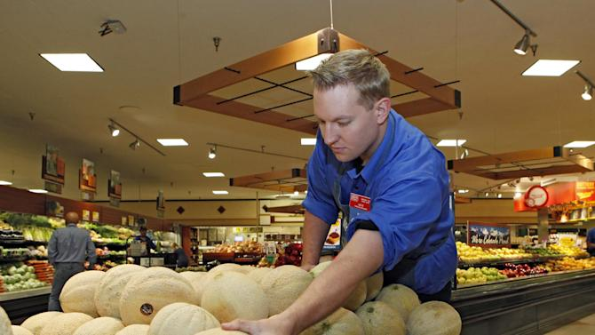 Produce manager Nate Codina arranges a display of Rocky Ford cantaloupes at a Denver Kings Soopers market on Friday, July 13, 2012.  Colorado cantaloupes are back in supermarkets Friday, and growers of the Rocky Ford melons are going on the offensive to restore the fruit's reputation a year after Colorado melons caused a deadly nationwide listeria outbreak. Farmers have banded together to trademark the melons and fund a new tracking system to prevent future outbreaks. (AP Photo/Ed Andrieski)