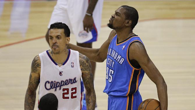 Oklahoma City Thunder's Kevin Durant, right, beats his chest as he walks past Los Angeles Clippers' Matt Barnes during the second half in Game 6 of the NBA Western Conference semi-finals on Thursday, May 15, 2014, in Los Angeles. The Thunder won 104-98