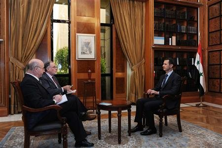 Syria's President Bashar al-Assad sits during an interview with journalists from Argentina in Damascus