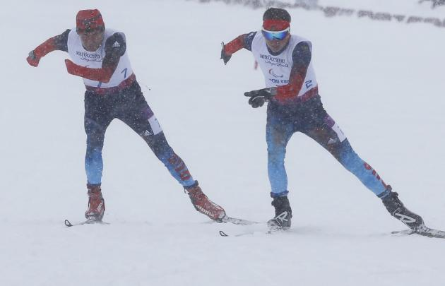 Russia's Kononov and Pronkov ski during the men's 1 km cross-country for the visually impaired at the 2014 Sochi Paralympic Winter Games in Rosa Khutor