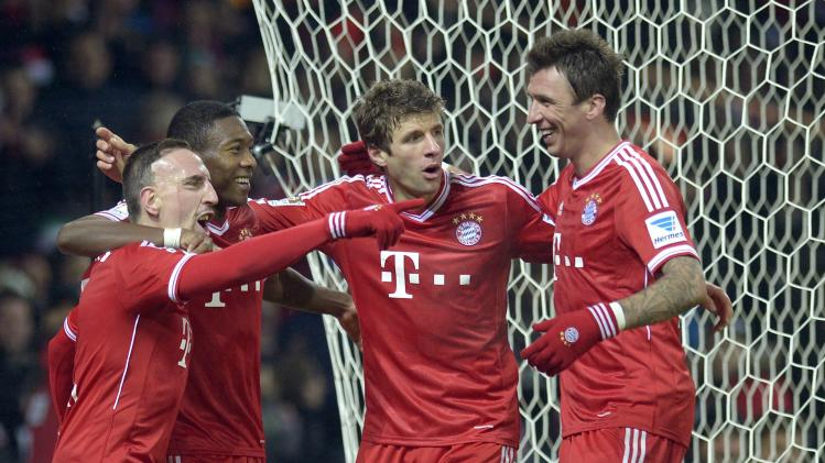 Bayern Munich's Ribery, Alaba, Mueller and Mandzukic celebrate after scoring during their German Bundesliga first division soccer match against Werder Bremen in Bremen