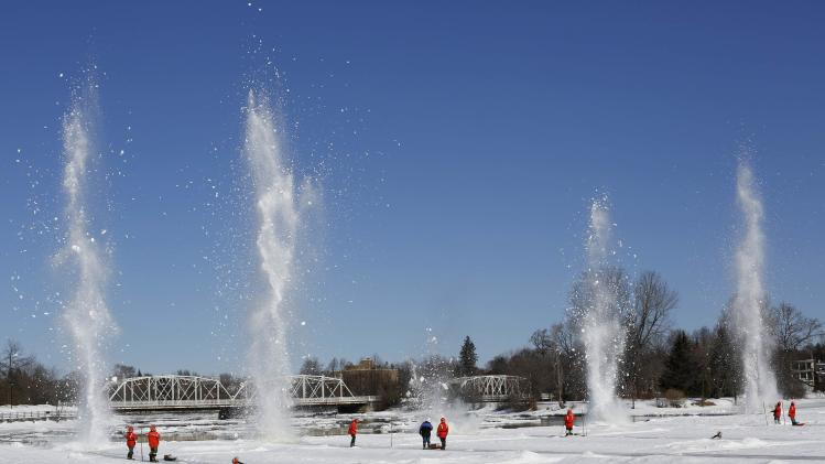 Workers set off explosives during ice breaking operations on the Rideau River in Ottawa