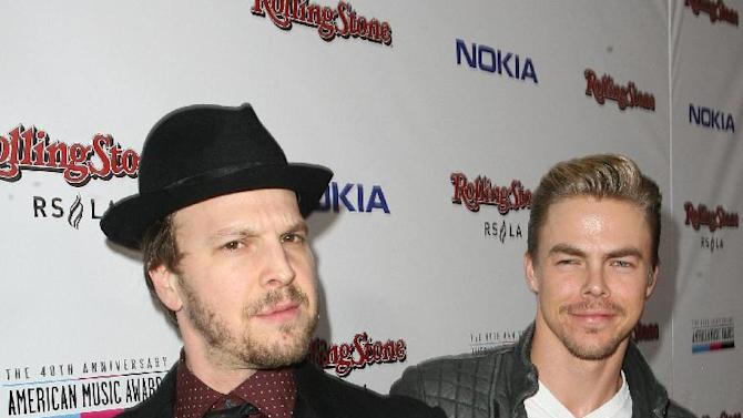 IMAGE DISTRIBUTED FOR NOKIA - Gavin DeGraw, left, and Derek Hough arrive at the Rolling Stone American Music Awards After Party, on Sunday, Nov. 18, 2012 in Los Angeles. (Photo by Casey Rodgers/Invision for Nokia/AP Images)