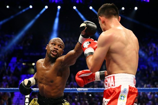 "Floyd Mayweather throws a left at Robert Guerrero during their WBC welterweight title bout in Las Vegas on May 4, 2013. Mayweather will put his undefeated record on the line when he fights Mexican champ Saul ""Canelo"" Alvarez on September 14"
