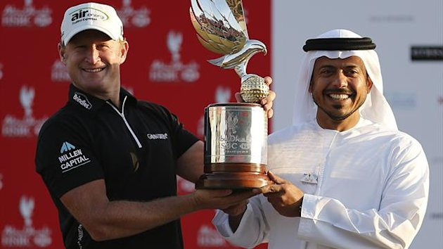 Jamie Donaldson of Wales (L) poses with his trophy near Sultan Bin Tahnoon Al Nahyan, the Chairman of the Abu Dhabi Tourism Authority (AFP)