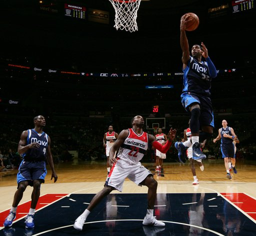 WASHINGTON, DC - JANUARY 1: O.J. Mayo #32 of the Dallas Mavericks shoots against Shelvin Mack #22 of the Washington Wizards during the game at the Verizon Center on January 1, 2013 in Washington, DC. (Photo by Ned Dishman/NBAE via Getty Images)