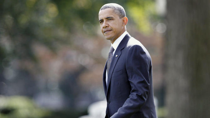 President Barack Obama walks across the South Lawn of the White House in Washington, Monday, Oct. 25, 2010, to board Marine One helicopter to travel to Providence, R.I. (AP Photo/Charles Dharapak)