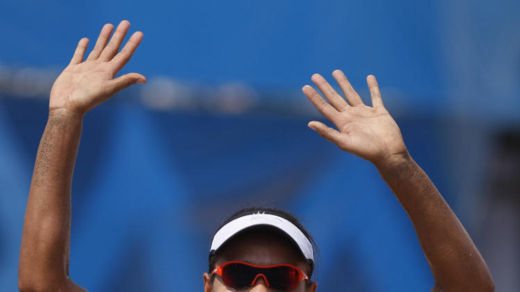 Brazil's Juliana Silva celebrates defeating Puerto Rico in a women's beach volleyball semifinal match at the Pan American Games in Puerto Vallarta, Mexico, Thursday Oct. 20, 2011. (AP Photo/Ariana Cubillos)