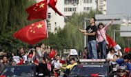 "Chinese protesters shout slogans and wave Chinese national flags during a protest in Luoyang, against Japan's ""nationalizing"" of the disputed Diaoyu Islands -- also known as Senkaku Islands in Japan. Angry demonstrators attempted to storm the Japanese embassy in Beijing, state media said, as tens of thousands of people across China protested against Japan over a growing territorial dispute"