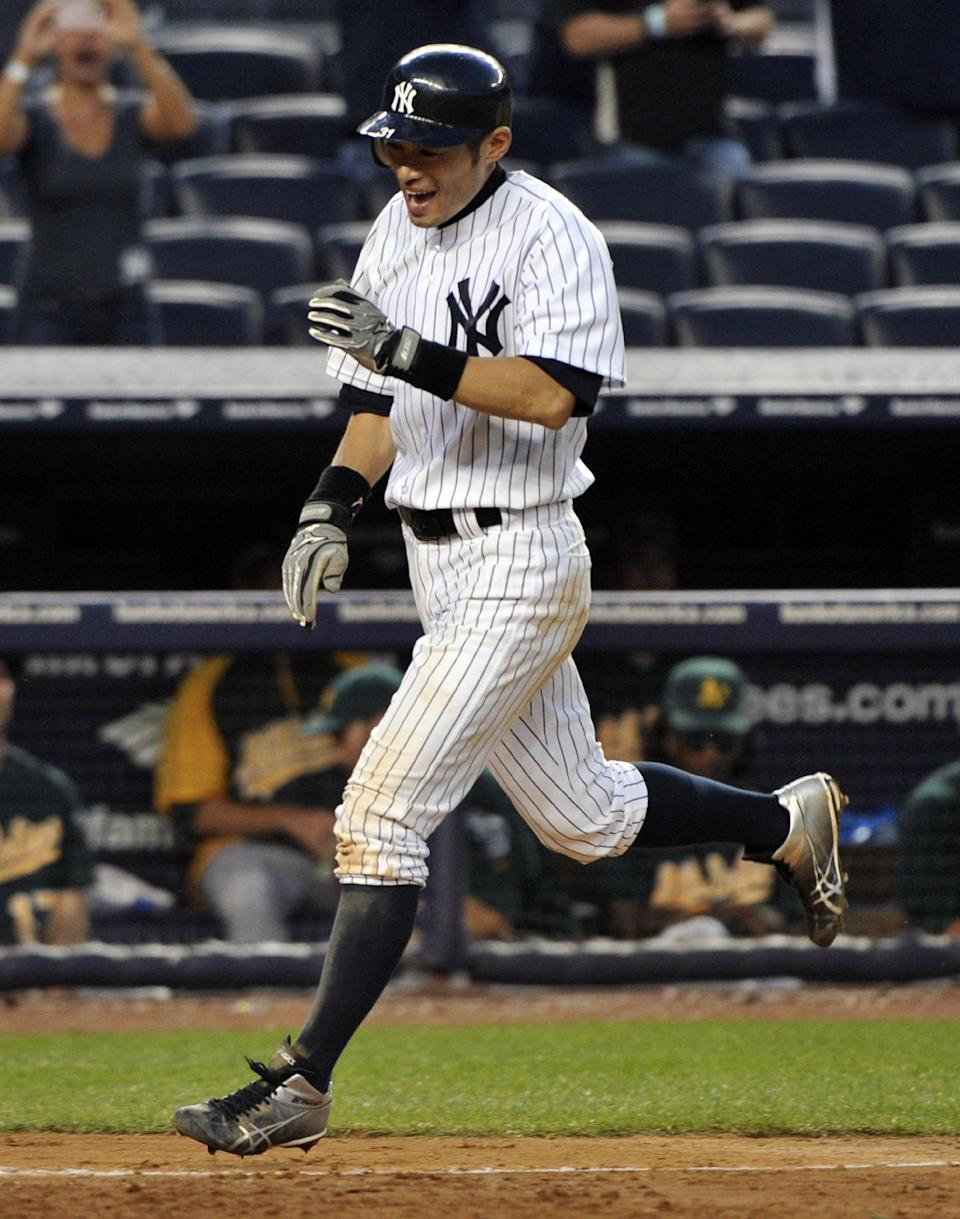New York Yankees' Ichiro Suzuki scores the winning run during the 14th inning of a baseball game against the Oakland Athletics, Saturday, Sept. 22, 2012, at Yankee Stadium in New York. The Yankees won 10-9. (AP Photo/Bill Kostroun)