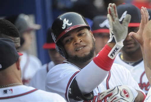 Braves win 10th straight behind 3 homers in 8th