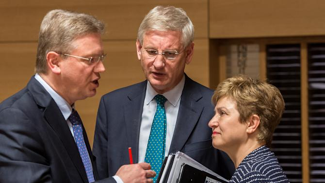 Germany's foreign minister Guido Westerwelle, left, talks with Sweden's foreign minister Carl Bildt, center, and European Commissioner for International Cooperation, Humanitarian Aid and Crisis Response Kristalina Georgieva at the start of an EU foreign ministers meeting at the Kirchberg Conference Center in Luxembourg, Monday, April 22, 2013. (AP Photo/Geert Vanden Wijngaert)