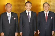 &lt;p&gt;This file photo shows Chinese PM Wen Jiabao (C) posing for a photo with Japanese economic leaders, head of the Japan Business Federation Fujio Mitarai (L) and Fujio Cho, chairman of Japan-China economic association, prior to a luncheon in Tokyo, in 2007.&lt;/p&gt;