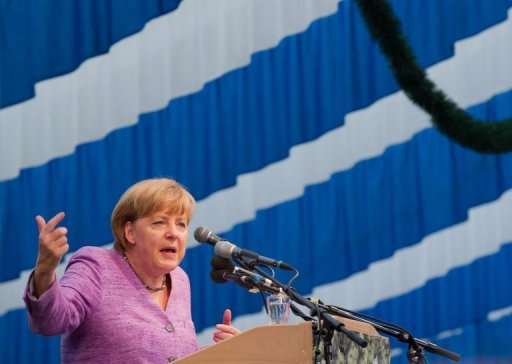 "<p>German Chancellor Angela Merkel has hit back at critics in her alliance who have questioned Greece's eurozone future by calling for ""solidarity"" with debt-wracked nations.</p>"