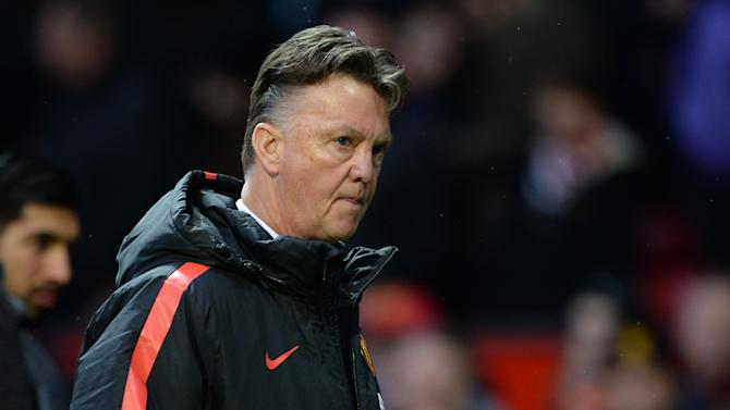 Manchester United's Dutch manager Louis van Gaal walks from the dug-out at half time in the English Premier League football match between Manchester United and Liverpool at Old Trafford in Manchester, north west England, on December 14, 2014