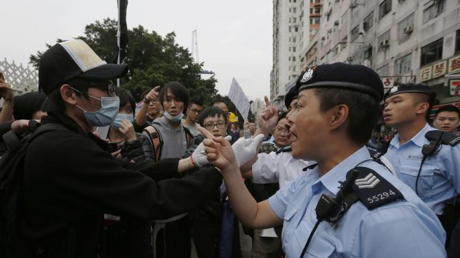 A protester argues with the police during a demonstration against mainland traders, at Yuen Long in Hong Kong