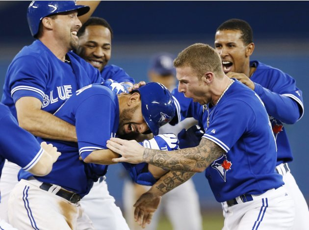Toronto Blue Jays' Bautista is congratulated after getting walk off single to beat Tampa Bay Rays during their MLB game in Toronto