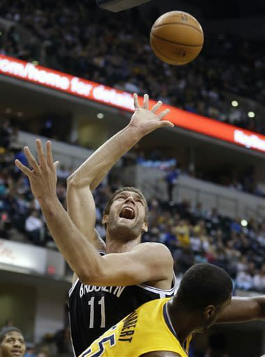 Nets beat Pacers, assured of at least No. 4 seed