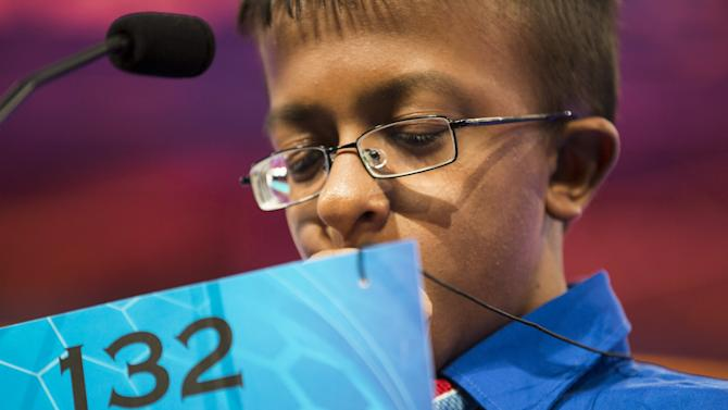"""Dev Jaiswal, of Jackson, Mississippi, ponders the word """"bacchius"""" during the final round of the 88th annual Scripps National Spelling Bee"""