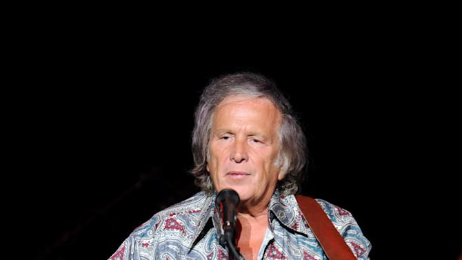 In this Juy 3, 2012 file photo provided by the Las Vegas News Bureau, Don McLean performs at the  Las Vegas Hotel and Casino in Las Vegas. McLean has been fined $400 for driving his Chrysler too fast through a school zone in Maine and has paid the levy. He had contested the charge in September, saying school zone warning lights weren't flashing. He had requested a trial. Police said during a 40-minute proceeding in Rockland District Court on Thursday, Jan. 24, 2013, the warning lights were flashing. Judge Patricia Worth found McLean had been speeding in a school zone in Rockport. But she lowered what would be a $515 fine if uncontested to $400. McLean immediately paid up. McLean lives in nearby Camden, along Maine's coast.  (Photo/Las Vegas News Bureau, Darrin Bush)