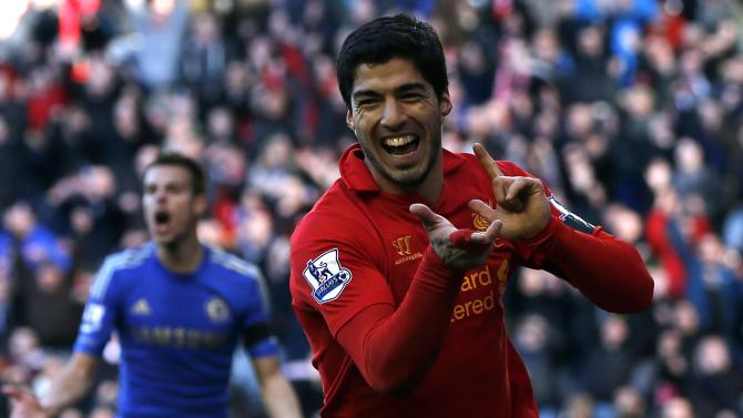 File photo of Liverpool's Suarez celebrating his goal against Chelsea during their English Premier League soccer match in Liverpool