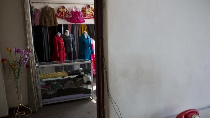 In this Feb. 20, 2013 photo, dresses stand in the showroom of a dress maker's shop in Pyongyang, North Korea. (AP Photo/David Guttenfelder)