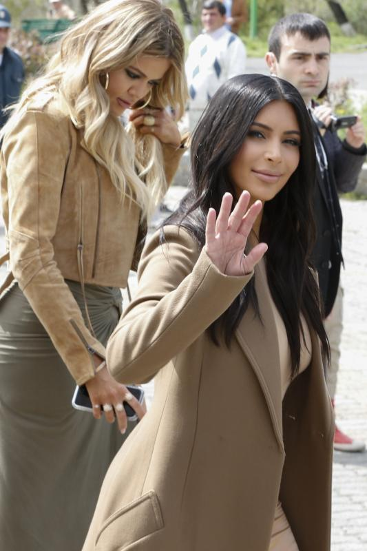 Kim Kardashian, front and sister Khloe Kardashian walk in Victory Park while filming in Yerevan, Armenia, Thursday, April 9, 2015. The Kardashian family arrived on Wednesday in the capital of their ancestral Armenia and earlier on Thursday met with Armenian Prime Minister Hovik Abrahamyan (AP photo/Artur Harutyunyan, PAN Photo)