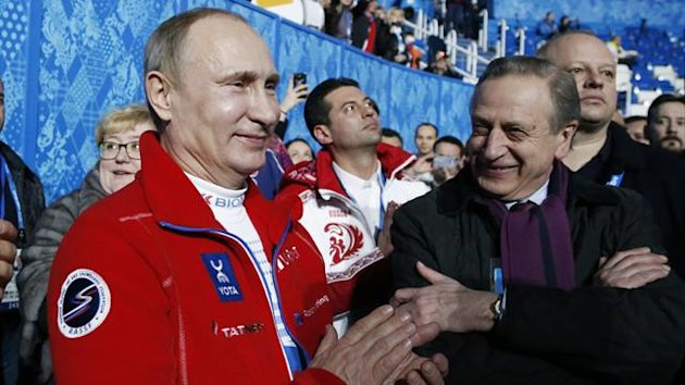 Russian President Vladimir Putin (L) applauds the gold medal-winning Russian figure skating team during the 2014 Sochi Winter Olympics, February 9, 2014. (Reuters)