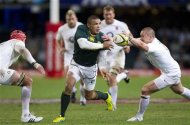South Africa's Habana is tackled by England's Brown during the first rugby test match in Durban